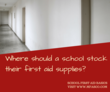 Where should a school keep their first aid supplies?